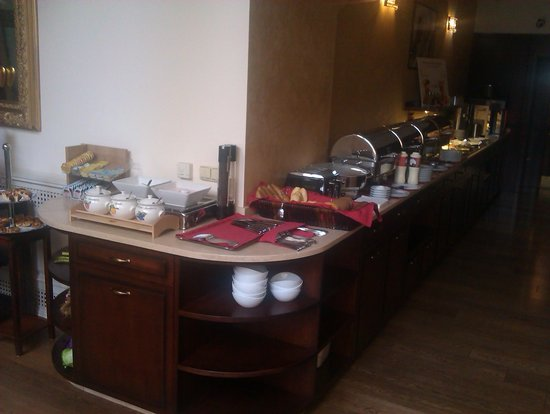 Boutique Hotel Seven Days: The hot food, bread, fruits, and coffee counter