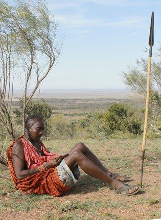 Maji Moto Maasai Cultural Camp : Maasai warrior resting