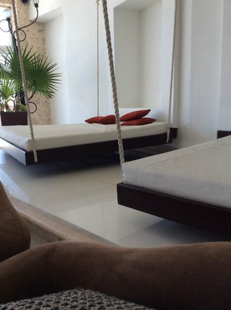 Hyatt Zilara Cancun : The lobby bar area .... these things are great to take a nap on!