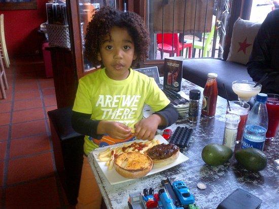Cafe Mojito: My son Jabez enjoying his burger @ Mojito