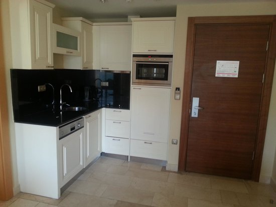 Goldcity Tourism Complex: kitchen area of family suite