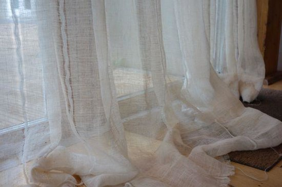 The Lamorna Cove Hotel: The curtains _are_ completely see through and heavily stained and frayed. The owner in his respo