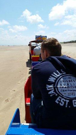 Sand Train: Little kids and big kids a like enjoy the surf train