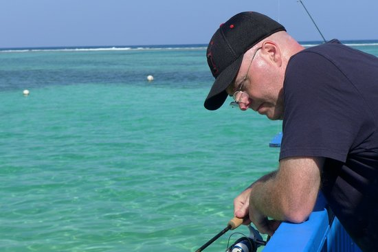 Tranquility Bay Resort: Patiently fishing off the deck