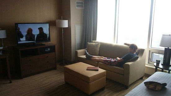 Homewood Suites by Hilton Halifax-Downtown, Nova Scotia, Canada: Travis relaxing beside the large window