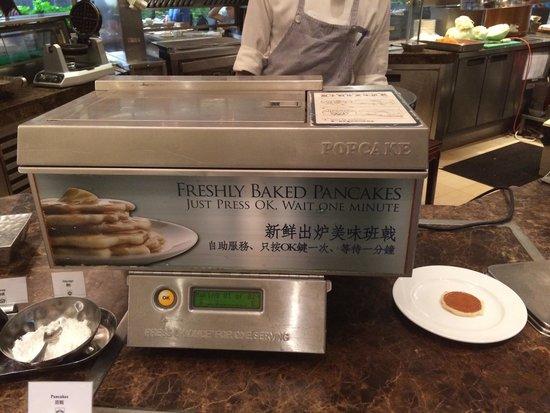 "The Royal Garden: Pancake ""printer"" at the buffet."