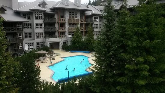 Coast Blackcomb Suites at Whistler : Pool view from the ski lift (hot tubs are to the right)