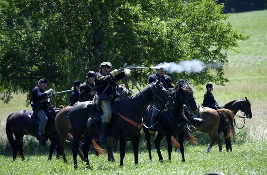 Annual Gettysburg Reenactment: Union cavalry attacking the Confederates Army
