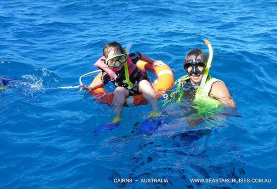 Seastar Cruises Reef Day Trips: Snorkeling Hastings Outer Reef  ~ Charisma assisted by Peter: host/crew member Seastar Cruises