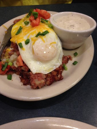 Main Street Overeasy: Corned beef hash over biscuits with your choice of two eggs, gravy on the side