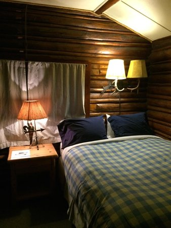 The Log Cabin Motel: Cozy Bed
