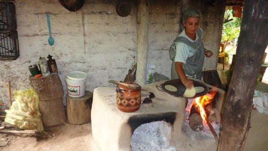 Vallarta Adventures: Local lady in village making fresh snack
