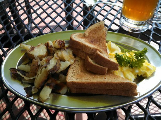 The Lookout Roadhouse : Basic breakfast with 2 scrambled eggs, wheat toast and potatoes (spuds). Love the ice tea.