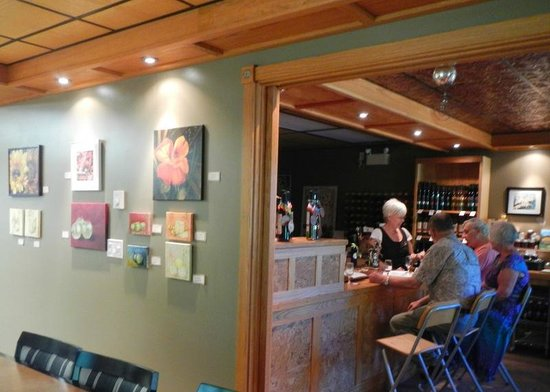 Blue Moon Winery: art work and Maria at work