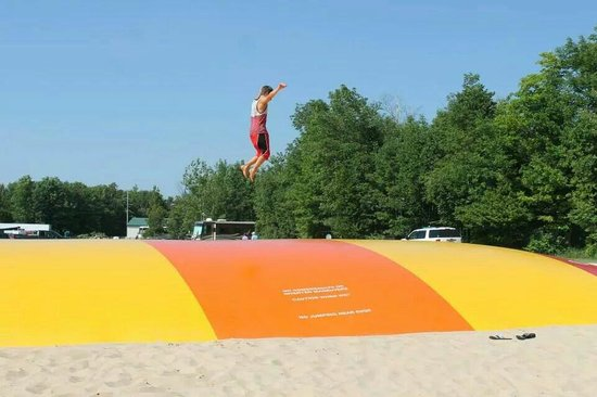 Door County Camping Retreat : Jumping pillow is a hit