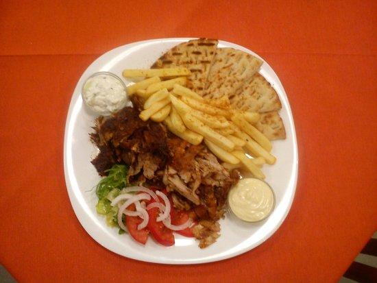 Rania's Grill House: Stuffed Chicken Slow Cooked on Spit