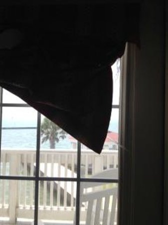 Lighthouse Inn at Aransas Bay: broken curtain drawstring on balcony window