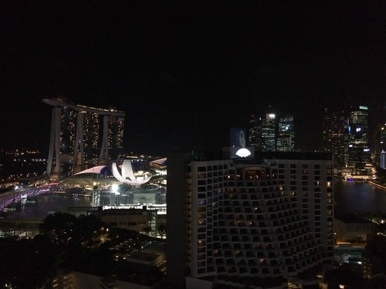 Pan Pacific Singapore: Nightly view from our room, overlooking Marina bay Sands and the harbor.