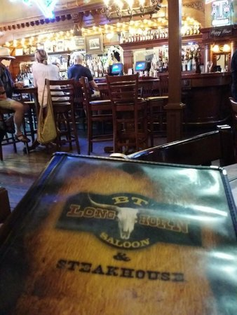 BT Longhorn Saloon & Steakhouse : Menu and the beautiful bar.. there are no bad seats in this building.