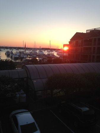 Wyndham Newport Onshore: Sunset off Living Room, facing marina, playground, pools and BBQ