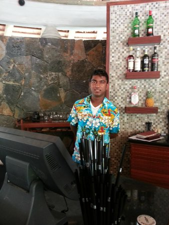 Emeraude Beach Attitude: Akash at the Bar