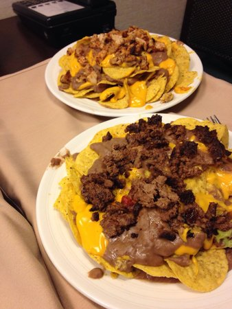 Embassy Suites by HIlton Corpus Christi : Texas Nachos- bean overload, canned cheese & old tasting meats. Can be yours yours for $10ea (ro