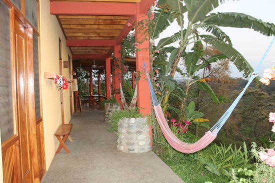 Costa Rica Yoga Spa: View of of lower exterior sidewalk by pool and rooms