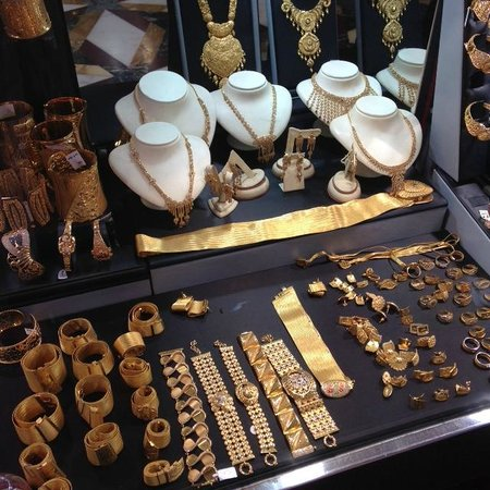 Gold Souk: Gold belts, even! There is one laid flat, and some rolled up