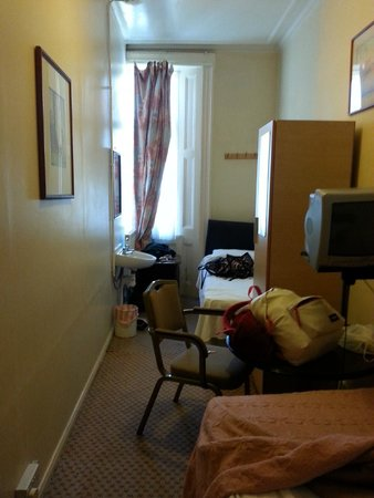 The Continental Hotel: Other bed, window and sink