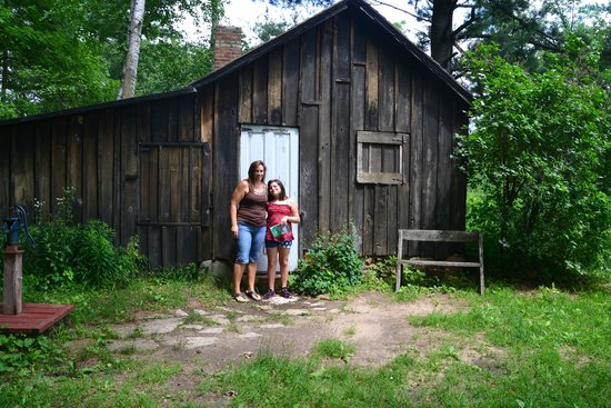 Aldo Leopold Foundation: Daughter and granddaughter if front of the cabin..