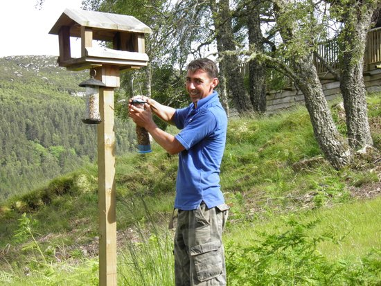 Eagle Brae: Colin topping up the birdfeeder