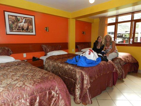 Casa de Luz / La Pequena Casita Hotel: Habitación triple muy cómoda
