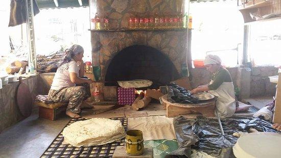 Imparator Hotel: woamen making pancakes, trout farm