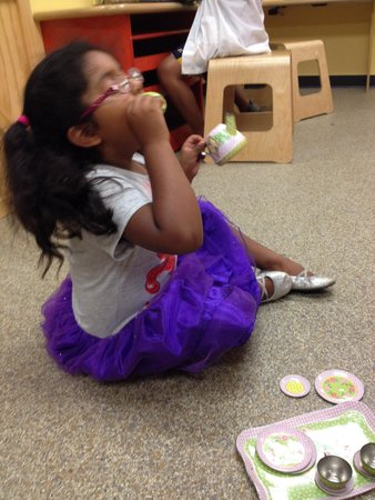 Illinois State Museum: Having a tea party in the children's playroom at the museum.