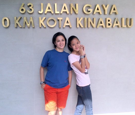 Hotel Sixty3: My Wife & Daughter in front of 63 Hotel Landmark