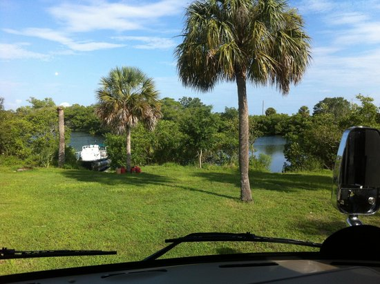 Ruskin, FL: front window view with tampa bay inlet and pontoon boat in back ground