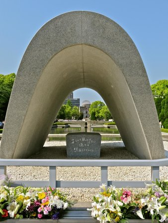 Hiroshima Peace Memorial Park : Cenotaph with flame  and A bomb dome