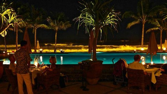 The Legian Bali: View of the pool and sea at night during dinner.