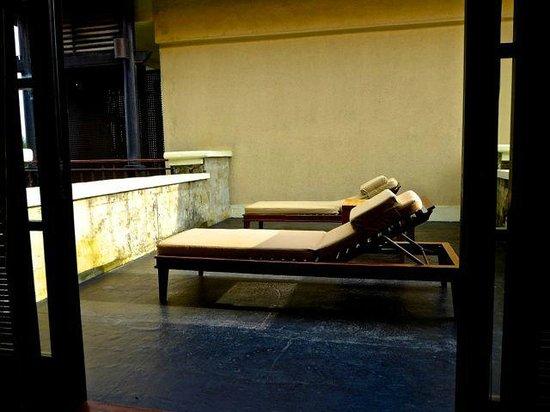 The Legian Bali : Sun loungers in the room.