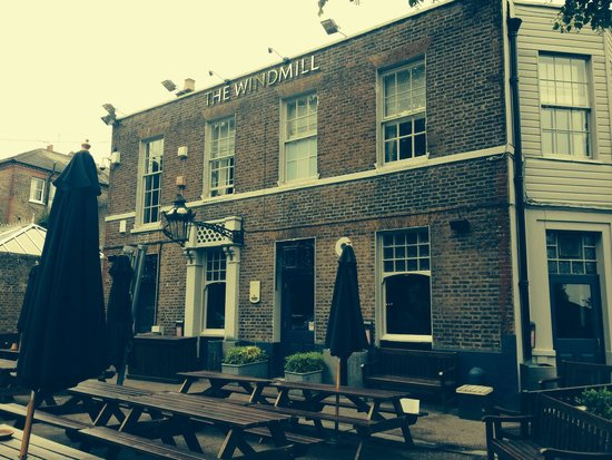 Windmill Clapham: From the outside....nice for a beer in the sunshine!