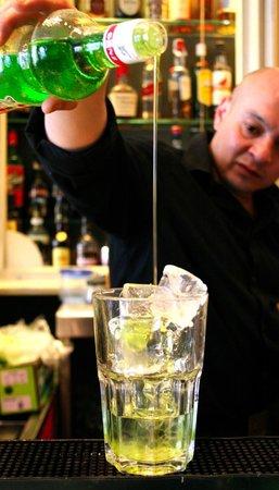 La Candelita: Bartender with a cocktail