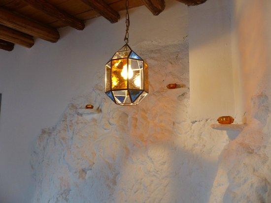 Casita de la Vaca: Moroccan inspired lighting adds to the unusual feature wall