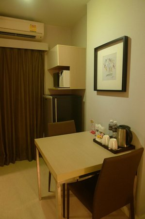 At Mind Executive Suites: Dinning table and fridge in room