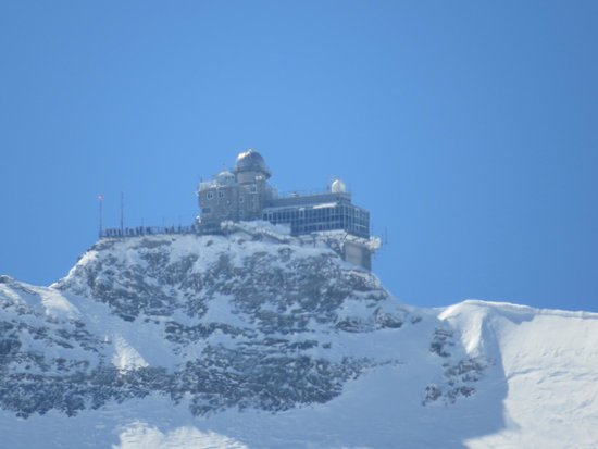 the jungfraujoch n the sphinx as seen from the ascending train