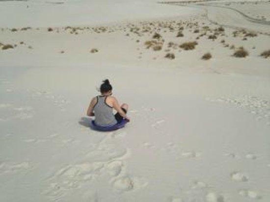 White Sands National Monument: Sliding down the dunes.