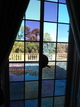 The Ringling: Looking through colored glass windows to the balcony