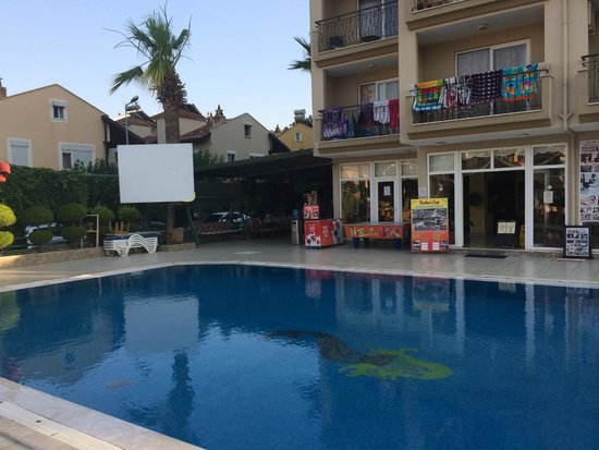Club Dorado Hotel: hotel and pool showing large tv screen