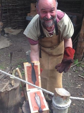 The Scottish Crannog Centre: Roy 'trainee' bronze metal worker with his first casting, great to watch.