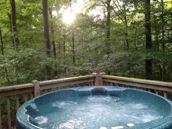 Cabins At Hickory Ridge: Luxury is... watching the sunset from the hot tub.