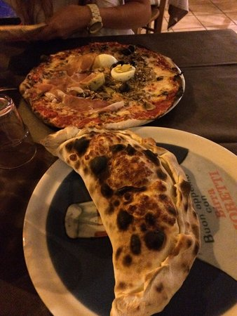 Grazie a Dio é Venerdi: Pizza y calzone